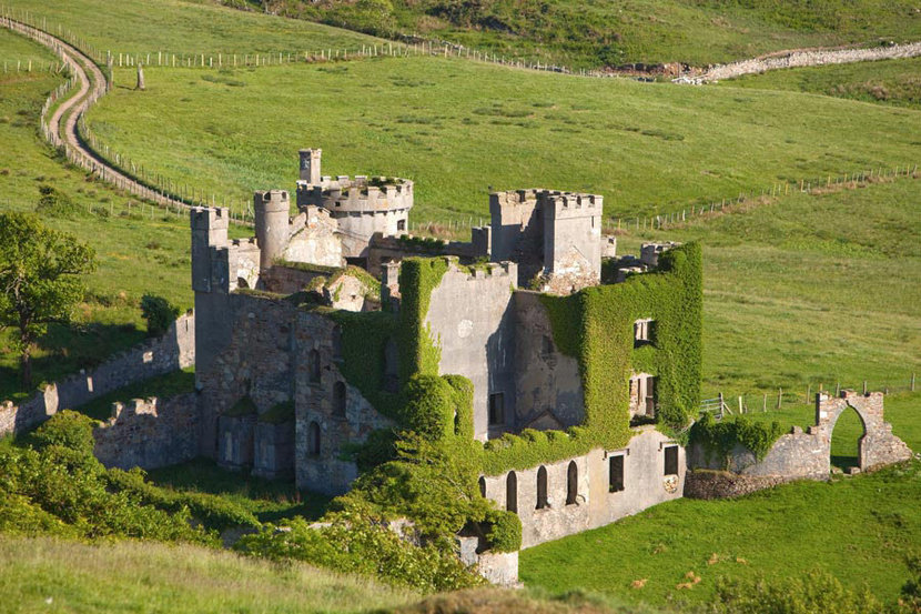 moss covered ancient ruins of 18th Century Clifden castle in galway ireland