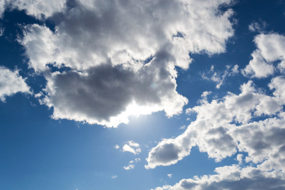 Blue Sky With Gray Clouds Wallpaper Mural