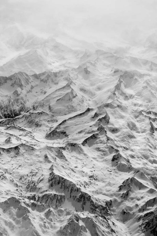 aerial view of snowy mountains creates a beautiful abstract image