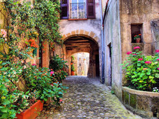 Arched Cobblestone Street In A Tuscan Village Italy Wallpaper Mural