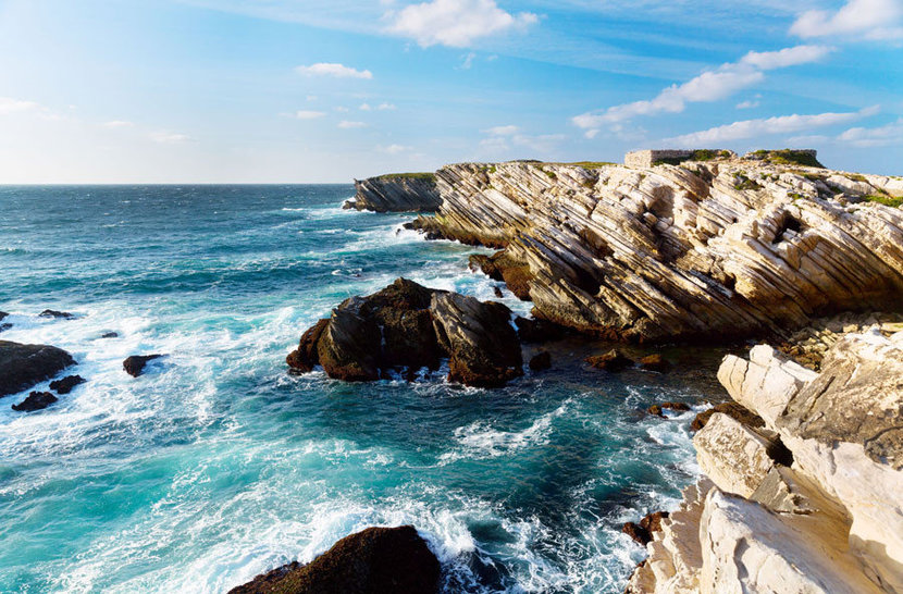 Crashing Waves beautiful teal waters lapping up against a jagged, rocky Portugal coast