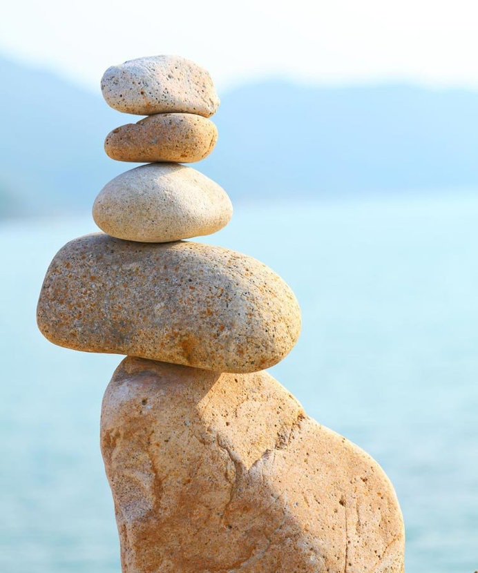 Rocks are stacked on top of one another in perfect balance and harmony