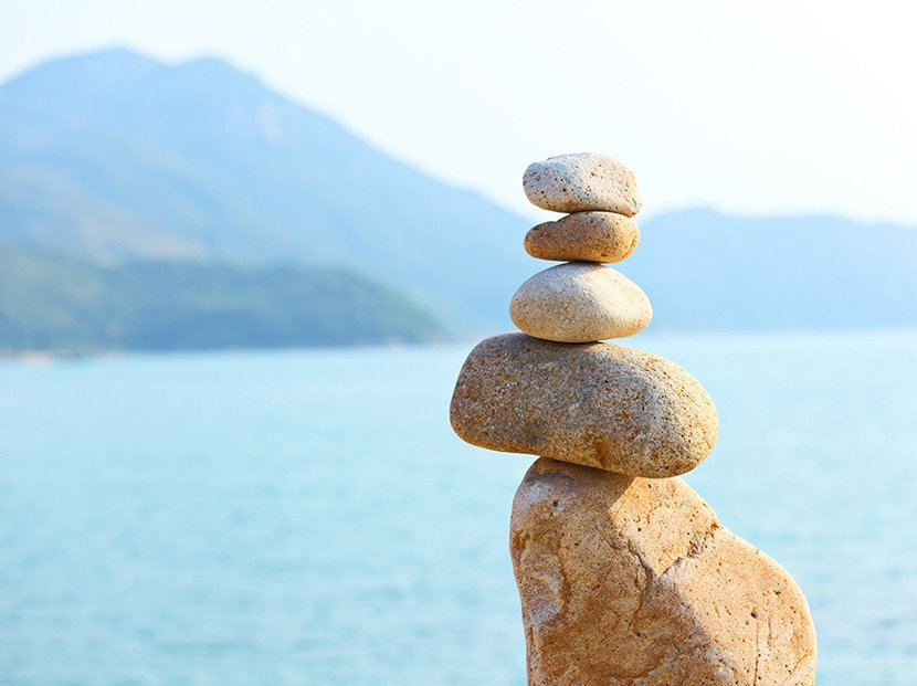 Zen wallpaper of stacking rocks balancing perfect for meditation and harmony