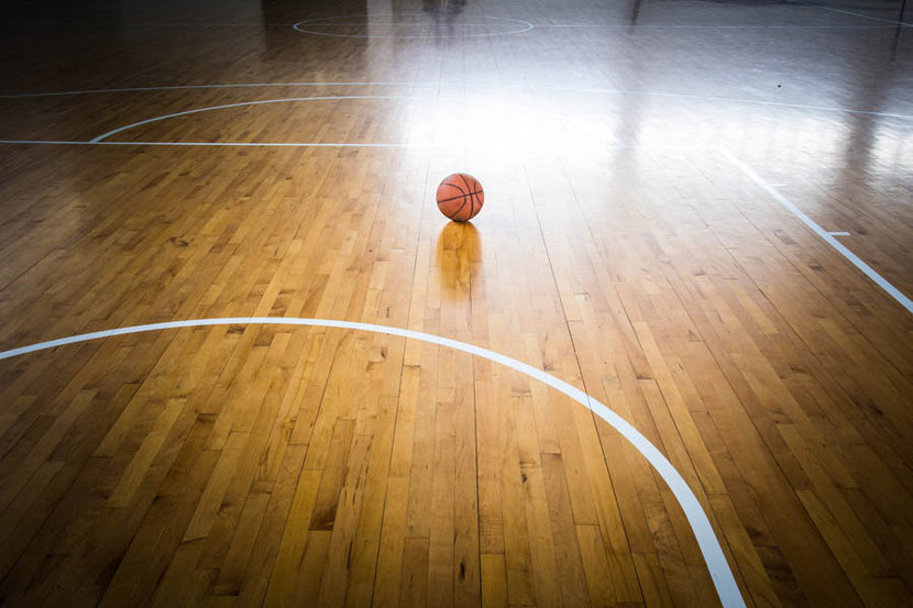 picture of basketball on gym floor background