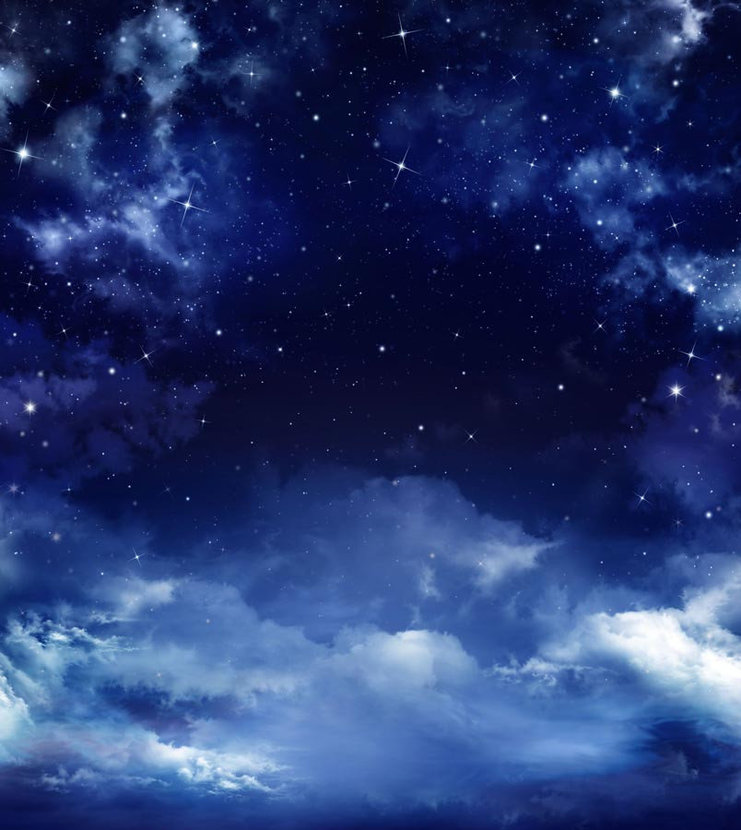 A beautiful blue starry sky filled with dreamy and billowing clouds
