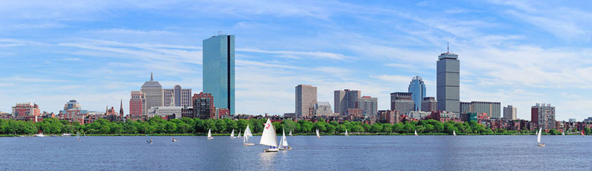 Charles River in Boston with sailboats on the water on a sunny day