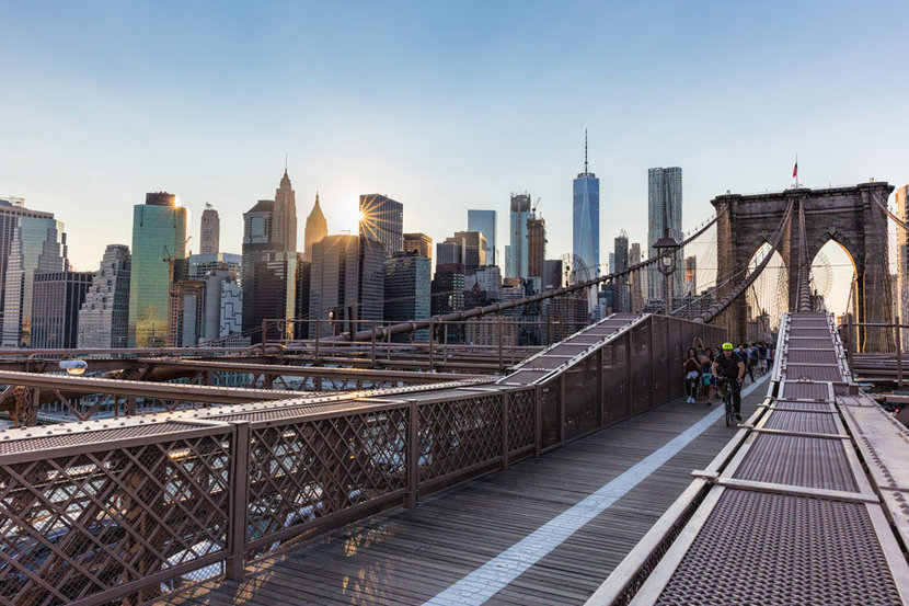 Brooklyn Bridge in NYC wallpaper with Manhattan streets and New York buildings