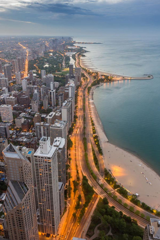 aerial view of Chicago skyscrapers along with Lake Michigan at sunset