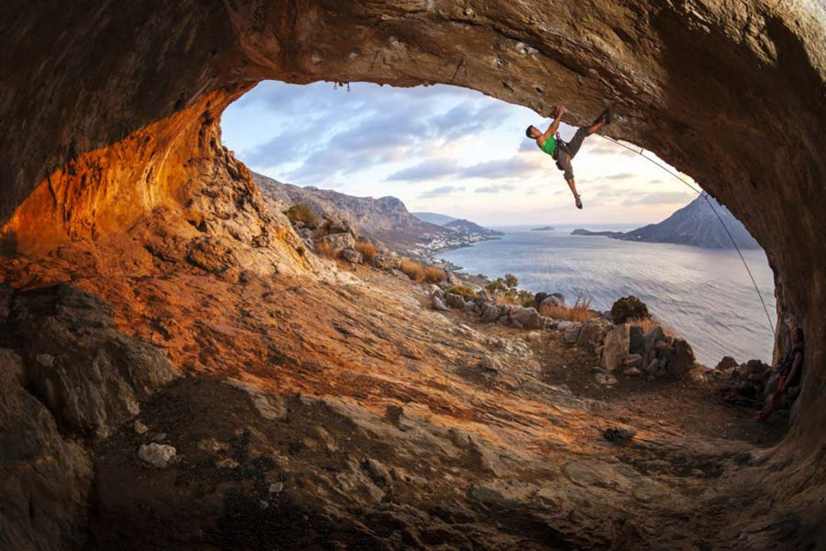 Climbing Along A Cave Roof Wall Mural