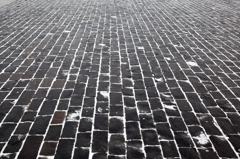 Close Up Cobblestone Pavement in Winter Time Wallpaper Mural