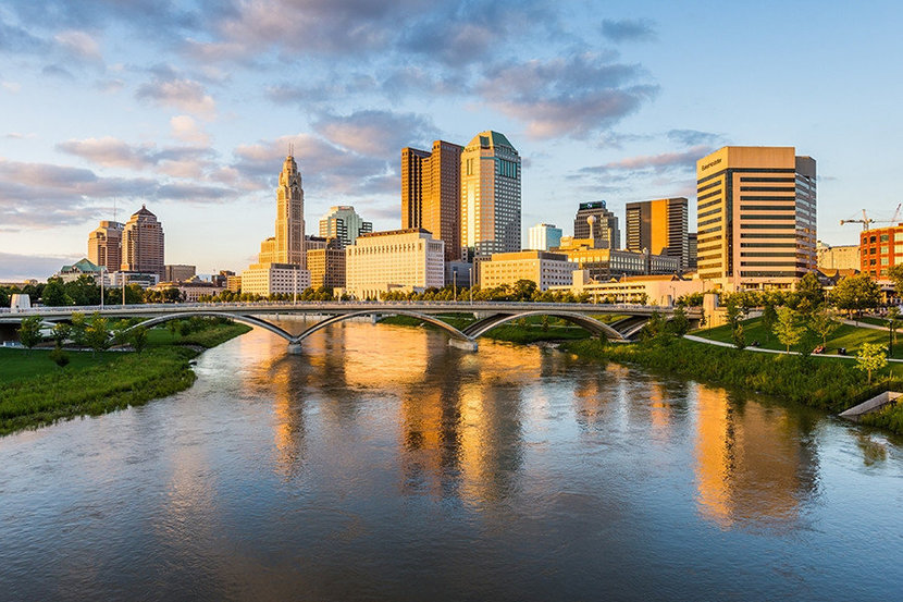 City of Columbus Ohio skyline with a view of the Scioto River, bridge, and skyscrapers