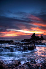 Cool Sunset over Rocks Mural Wallpaper