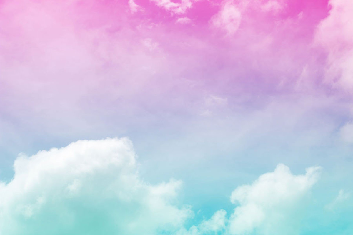 Puffy clouds in striking colors, from teal to purple to pink