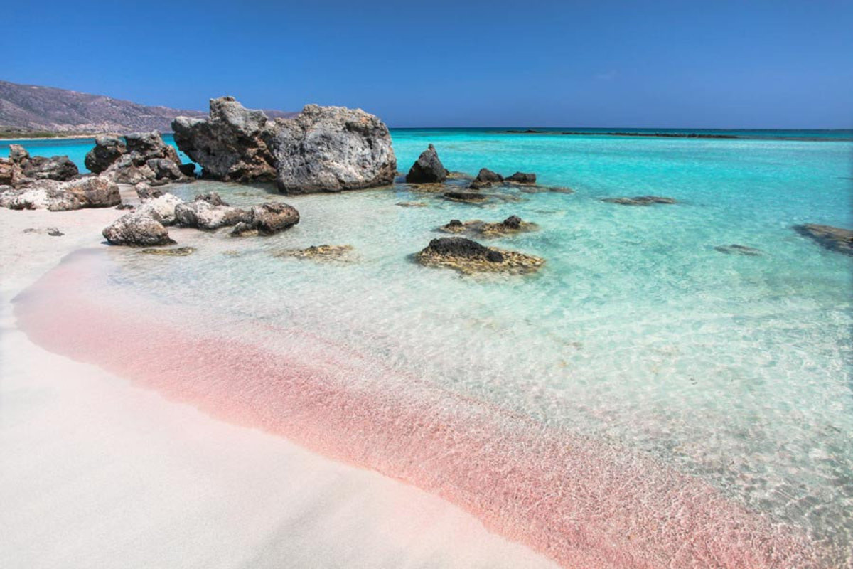Elafonissi Beach's pink sands are kissed by the luminous, crystal blue water of the ocean