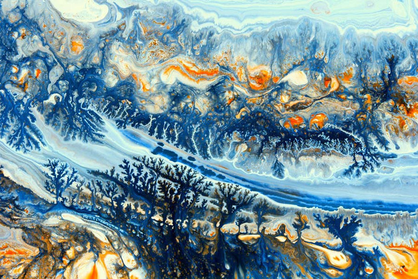 Shades of blue and orange mingle with each other and form an abstract landscape of sorts