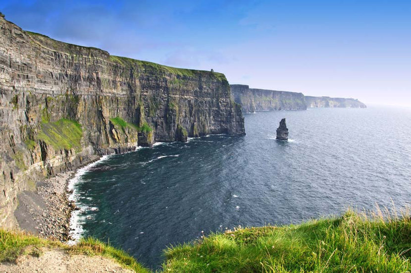Sun shines down upon the cliffs of Moher in Ireland