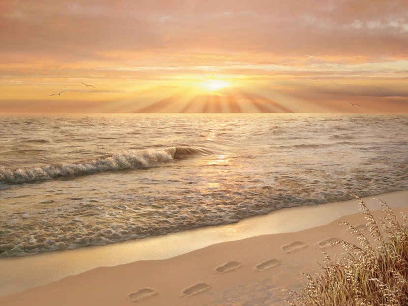 Biblical picture of footprints in the sand prayer with ocean waves and a beautiful sunset in the distance