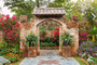 stone doorway leads into a lush, colorful garden with a variety of flowers and plants