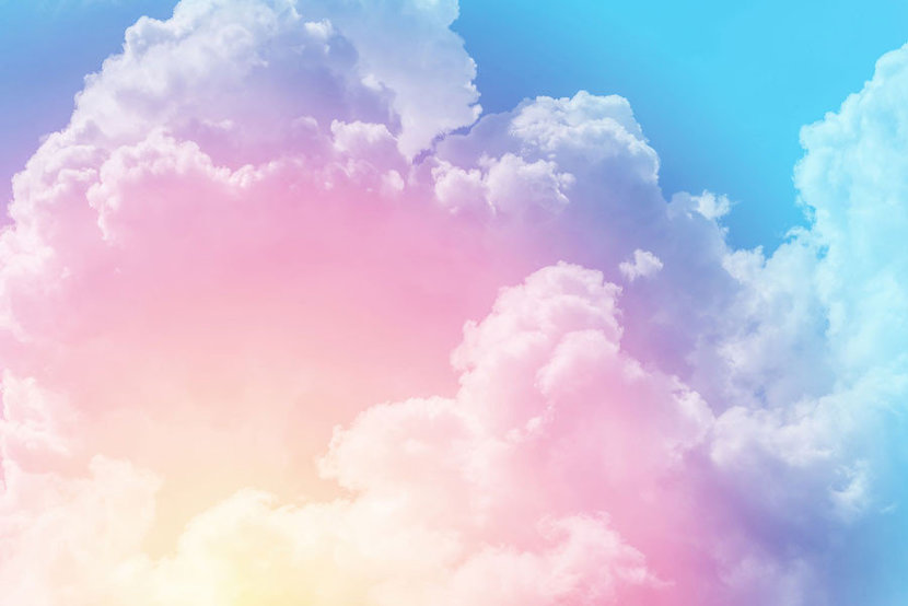 Enormous puffy clouds in a vivid color scheme fill this striking design