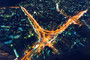 cityscape wall mural depicts an aerial view of a massive highway intersection in Tokyo, Japan
