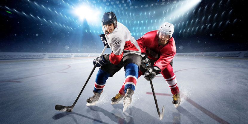 Hockey Players Chasing The Puck