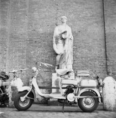 Lambretta Parked On Cobblestone Street Mural Wallpaper