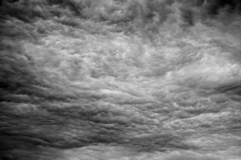 a dramatic black and white image of a sky filled with ominous clouds
