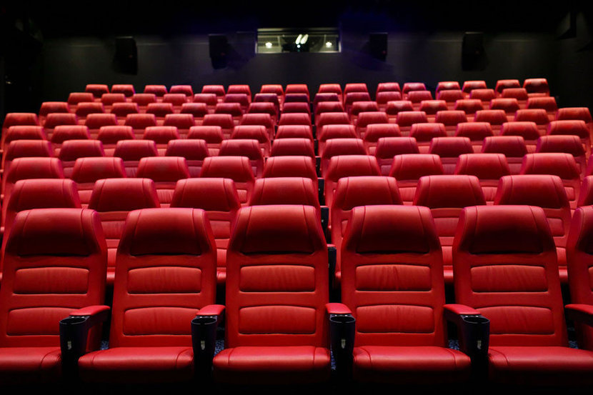 movie theater or cinema empty auditorium with red seats