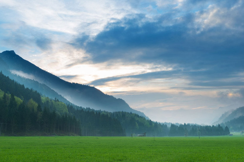 a misty morning vista of the Tyrol Alps in Austria