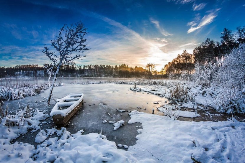 Old-Boat-On-The-Lake-Covered-With-Snow.jpg