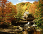 Old Grist Mill in an autumn forest near a river