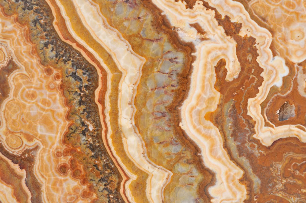 Texture of onyx or marble stone with yellow, honey, and brown colors