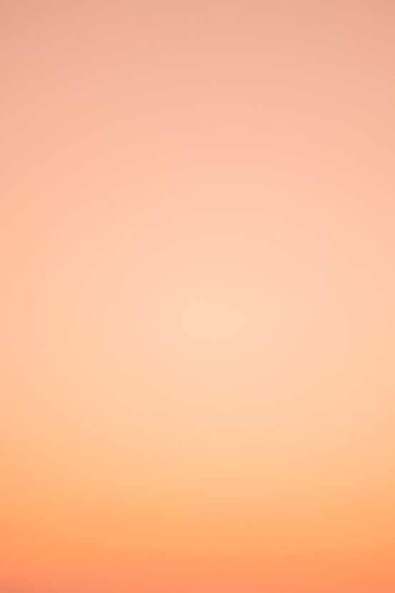 Ombre background with pastel orange and coral coloring