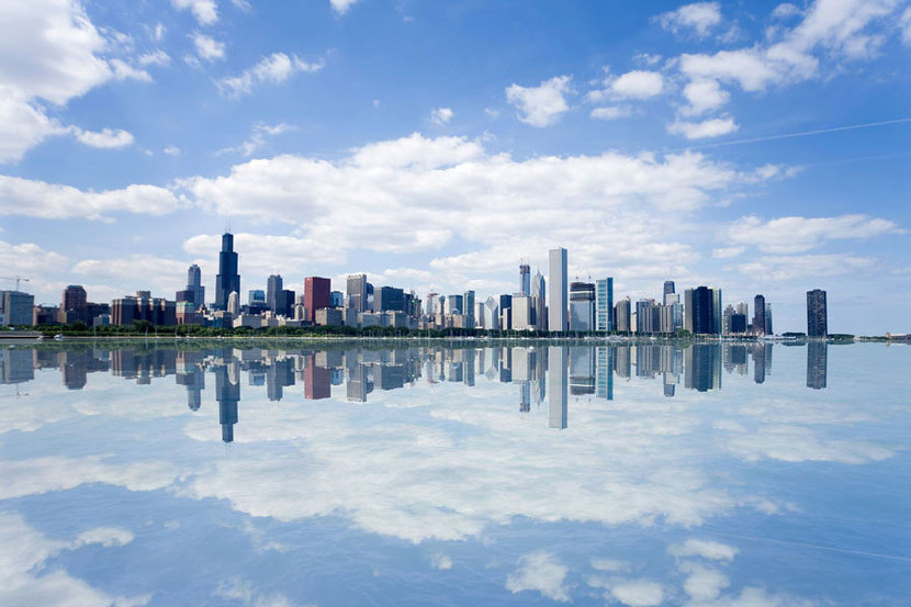 Reflections of Chicago skyline on lake