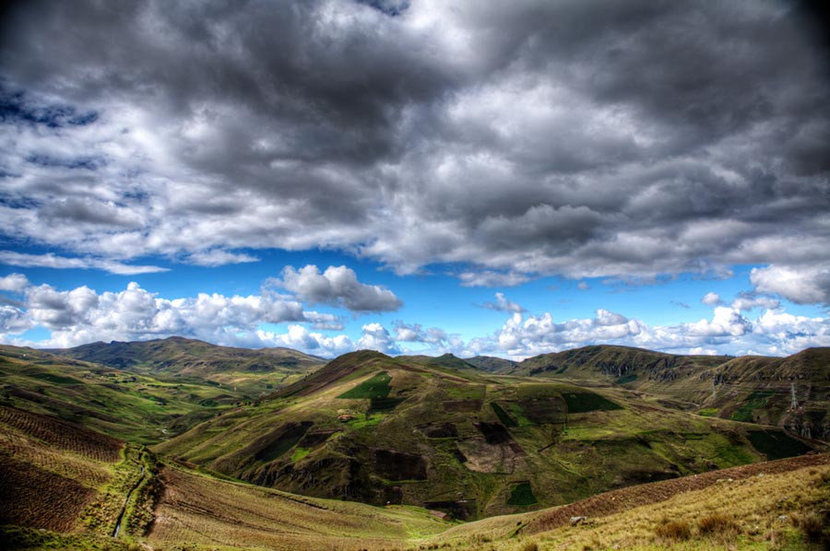 Patchwork Green Mountains with Clouds Mural Wallpaper