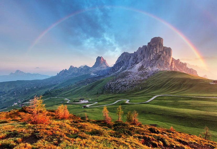 Alps changing of the seasons while capturing a breathtaking rainbow