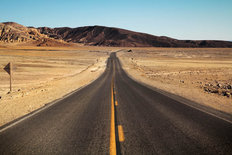 Road in Death Valley Surrounded By The Desert Mural Wallpaper