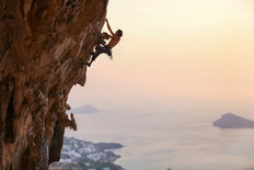 Rock Climber at Sunset in Greece Wall Mural