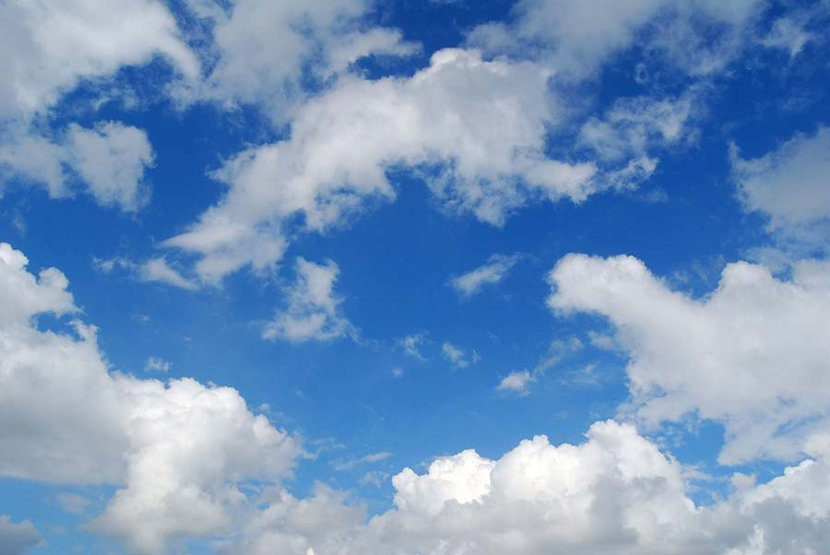 Puffy White Clouds Mural Wallpaper