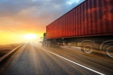 Semi Truck Driving Into Sunset Wall Mural