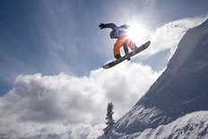 Snowboarding on a Sunny Day Wall Mural