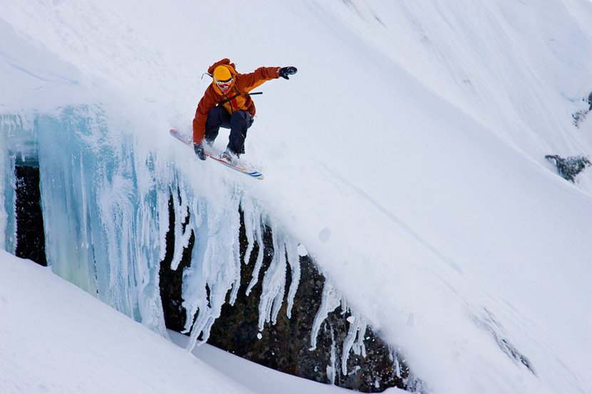Snowboarding Over a Snowy Cliff Mural Wallpaper