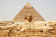Sphinx With Pyramids In Background Wall Mural