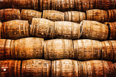 Stacked Pile of Old Whiskey And Wine Barrels Wallpaper Mural
