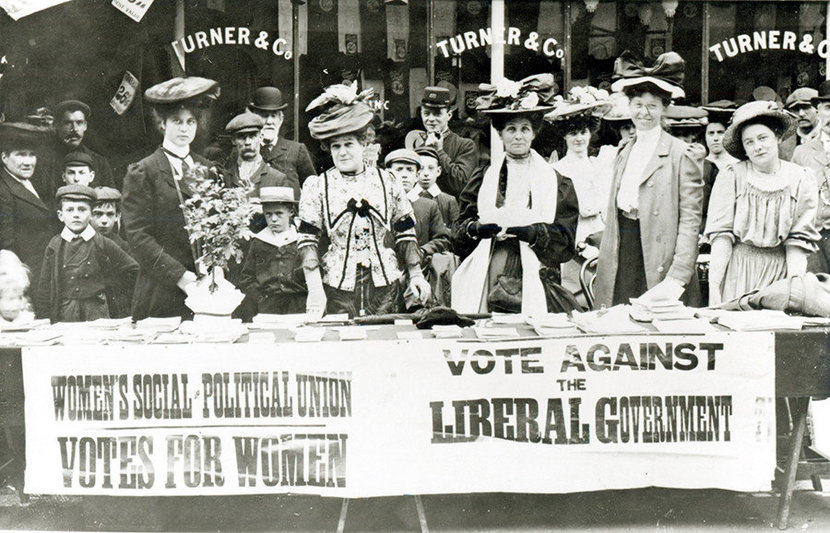 Suffragettes at a campaign stand Wall Mural