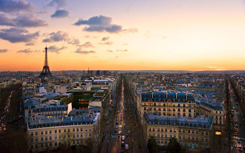 European city Paris at sunset, the Eiffel Tower in the distance