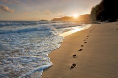Sunrise Beach With Footprints In The Sand Wall Mural