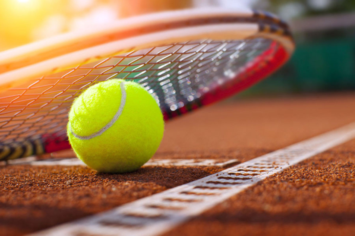 Tennis ball And racket on tennis court