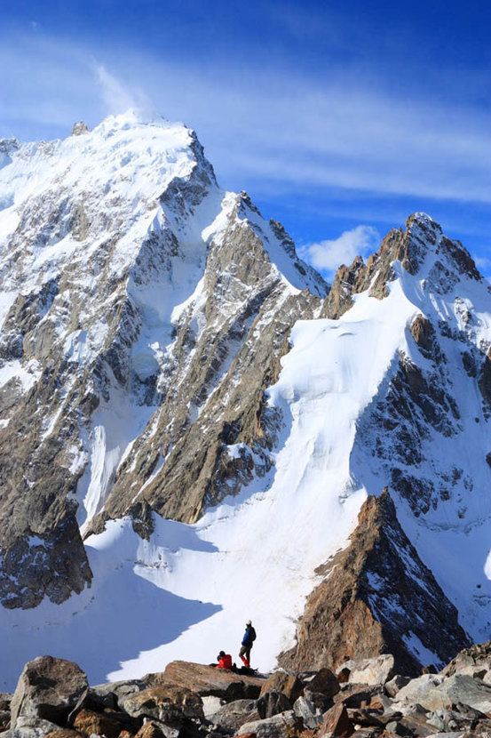 Two Climbers Against The Backdrop Of The Mountains Wallpaper Mural