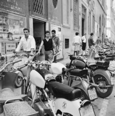 Various Scooters Parked On A Street In Rome Wall Mural